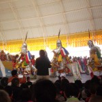 Gesar dancers performing in front of HH Karmapa and Gyaltsap Rinpoche on the far left