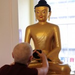 Adjusting the Buddha statue