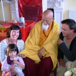 Lama Yeshe Rinpoche with family at tea party