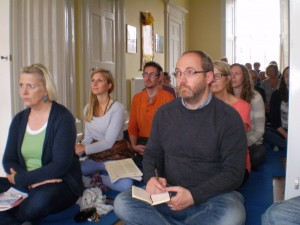 Students taking notes at Lama Yeshe Losal Rinpoche's Teachings