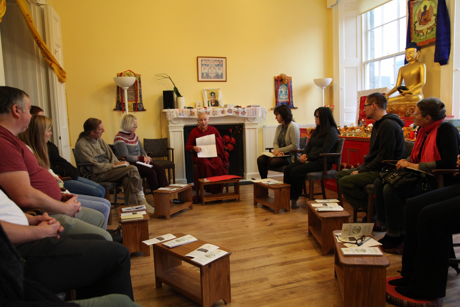Ani Rinchen Khandro and volunteers come together to discuss our new Centre