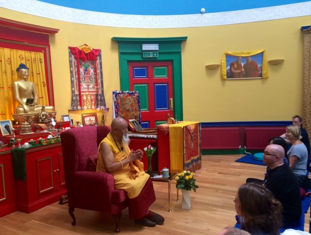 Lama Yeshe Rinpoche and audience